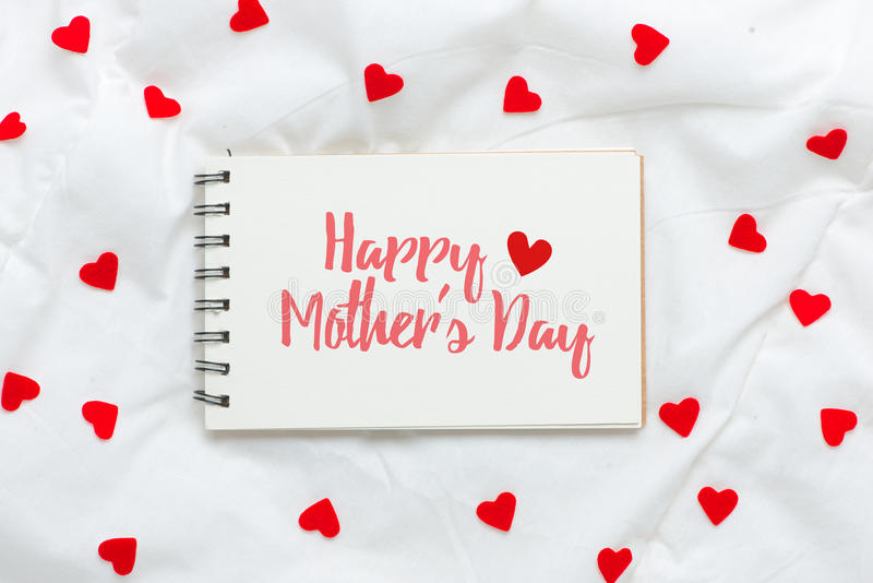 Happy mothers day on empty sheet of paper with red hearts stock images