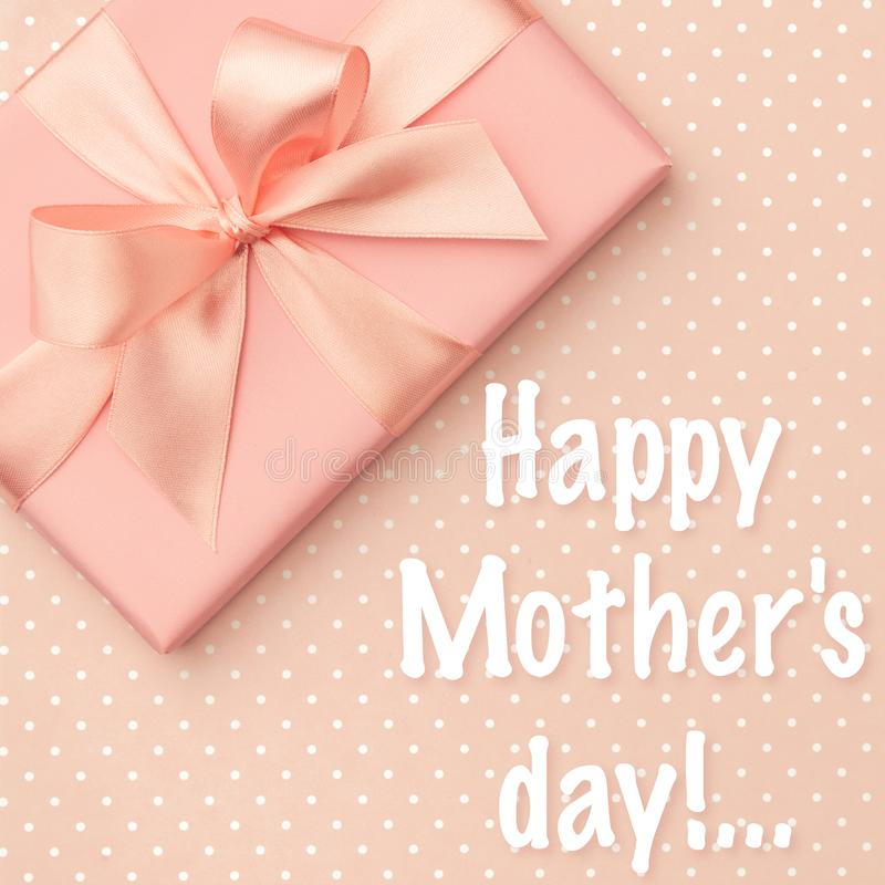 Happy Mothers Day greeting card decorated gift box flat lay on living coral color background. Top view stock images