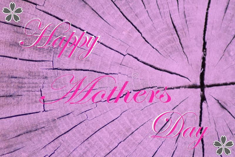 `Happy mothers day` inscription on violet pink wooden background. royalty free stock photo