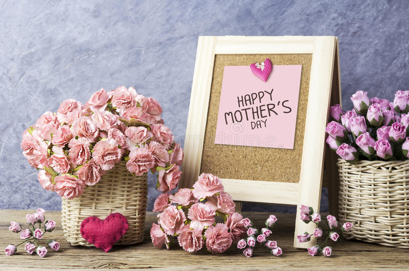 Happy mothers day message on blackboard and paper carnation stock photo