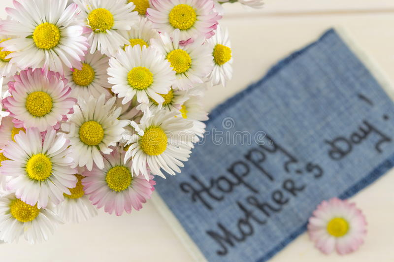 Happy mothers day note with flowers royalty free stock photography