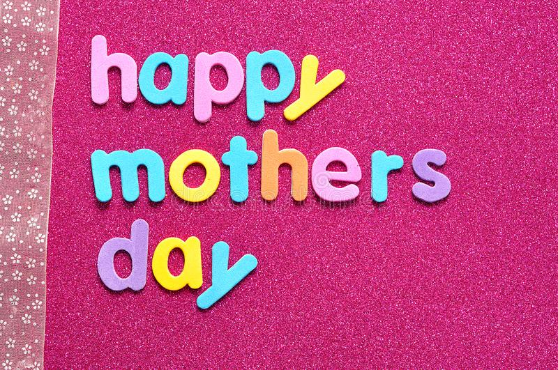 Happy mothers day on a pink background with a pink ribbon stock images