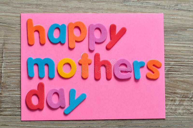 Happy mothers day on a pink note royalty free stock photography