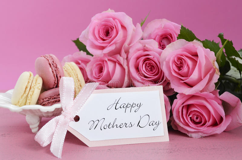 Happy Mothers Day Pink Roses and Macarons. stock images