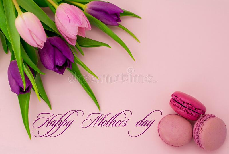 Happy mothers day text. Beautiful tulips with colourful biscuits macaroon and blueberry raspberries. Happy mothers day text.. March, background, bakery stock photography