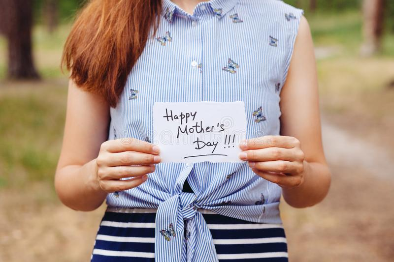 Happy mothers day - girl with text on card on nature royalty free stock photos