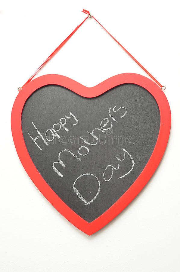 Happy mothers day written on a blackboard royalty free stock photos