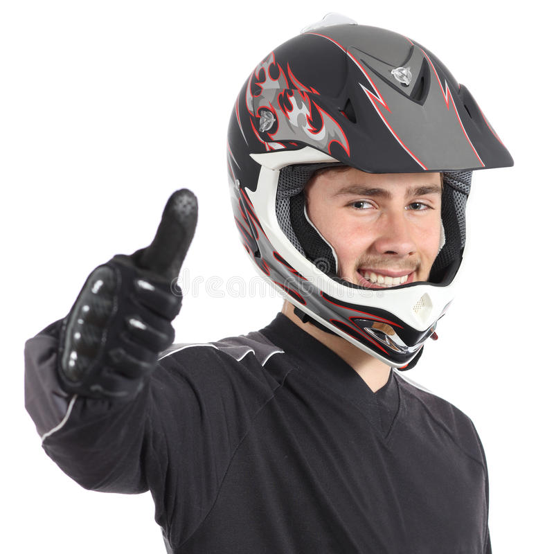 Happy motor biker man gesturing thumbs up. Isolated on a white background stock photo