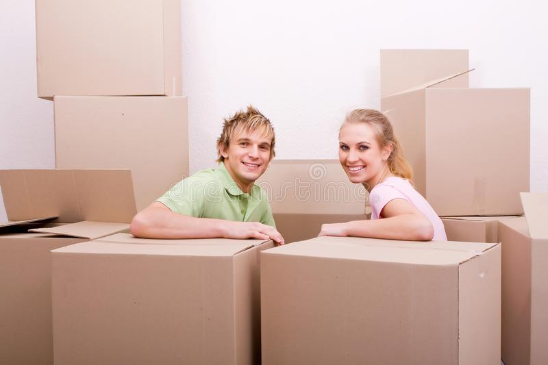 Happy moving couple royalty free stock photography