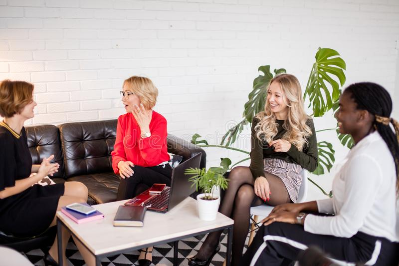 Happy multi-ethnic female friends meeting at hall after corporate training royalty free stock photos