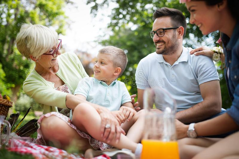 Multi generation family enjoying picnic in a park royalty free stock photos