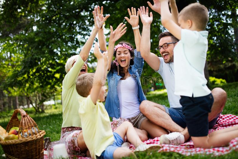Multi generation family enjoying picnic in a park stock photography