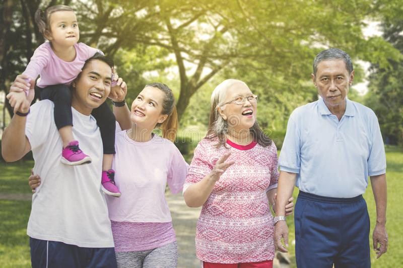 Happy multi generation family stands in the park stock photos