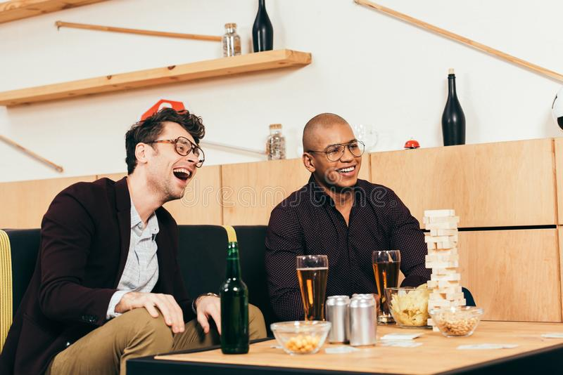 Happy multicultural business colleagues spending time together stock photography