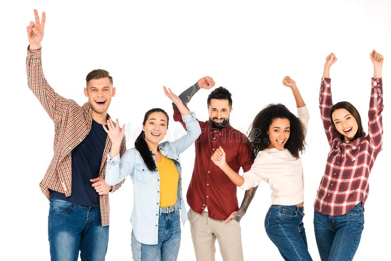 happy multicultural group of people smiling with hands above head isolated stock images