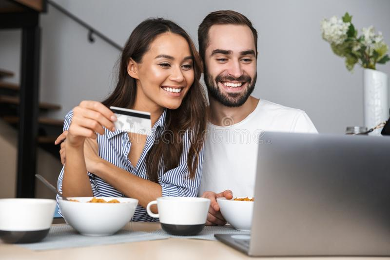 Happy multiethnic couple having breakfast stock image
