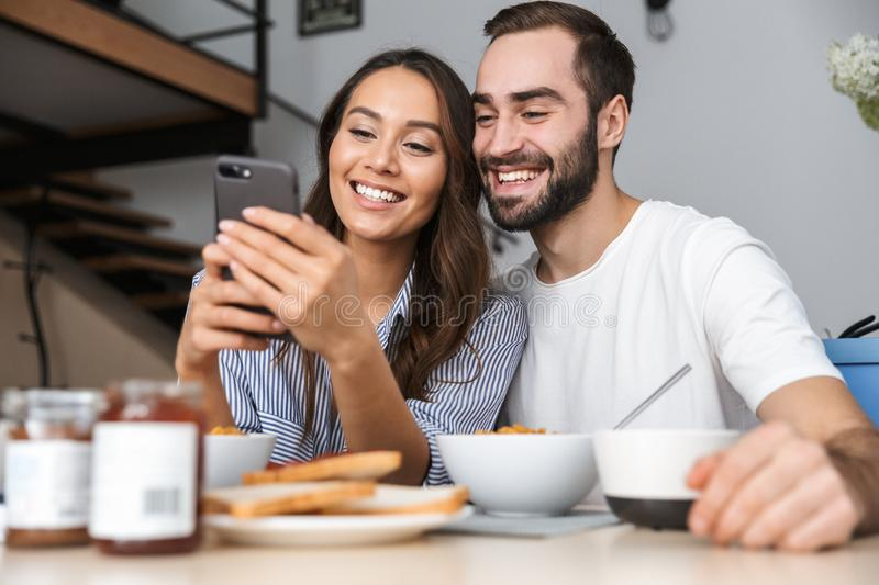 Happy multiethnic couple having breakfast stock photo