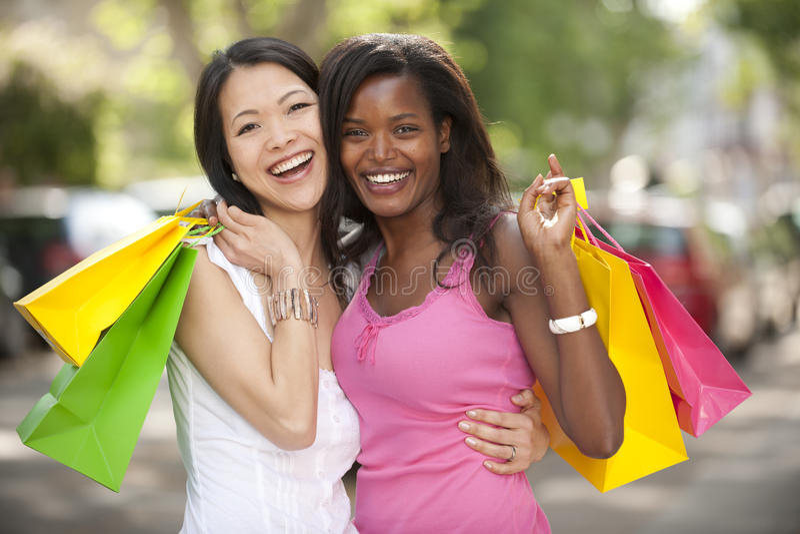 Happy multiethnic friends shopping stock photos