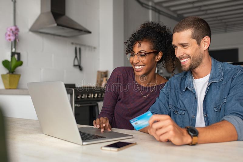 Happy multiethnic ouple making online payment royalty free stock photo