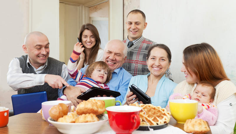 Happy multigeneration family with electronic devices royalty free stock photos