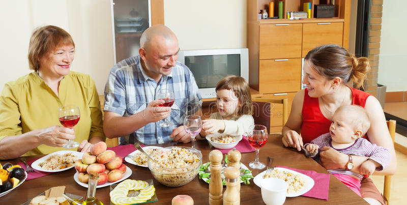Happy multigeneration family over holiday table royalty free stock image