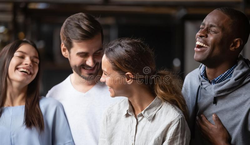 Happy multiracial friends group smiling bonding having fun together royalty free stock image