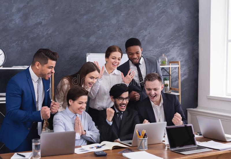 Happy multiracial managers successfuly completed hard project. Happy multiracial young managers successfuly completed hard project royalty free stock photography