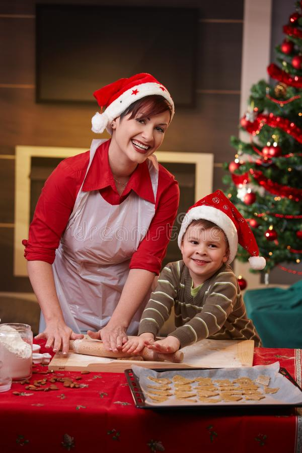 Happy mum baking with son for christmas