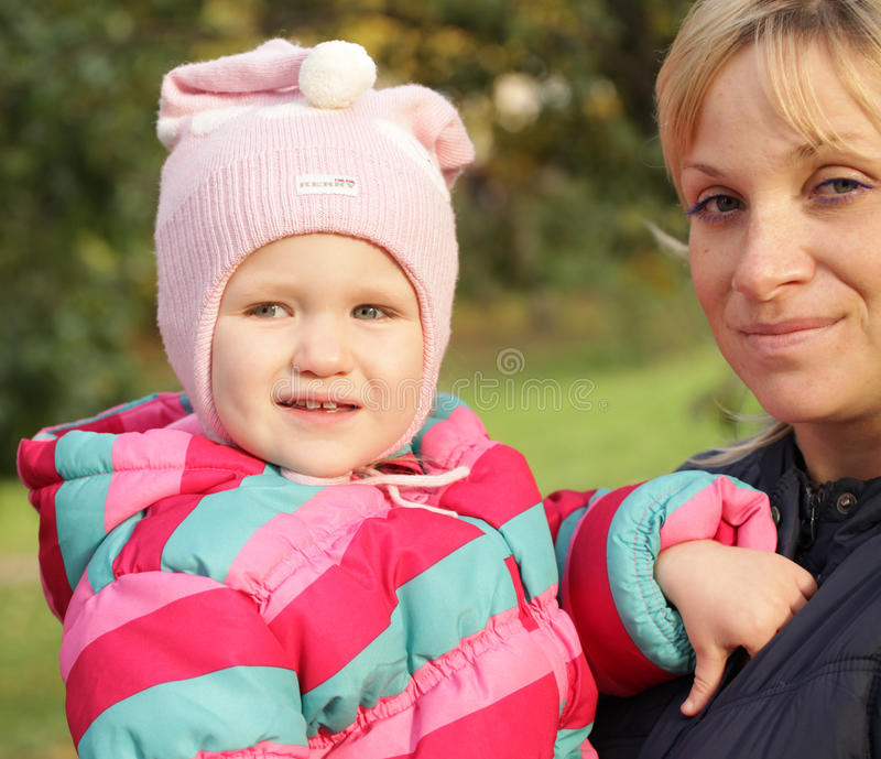 Happy mum with a daughter stock images