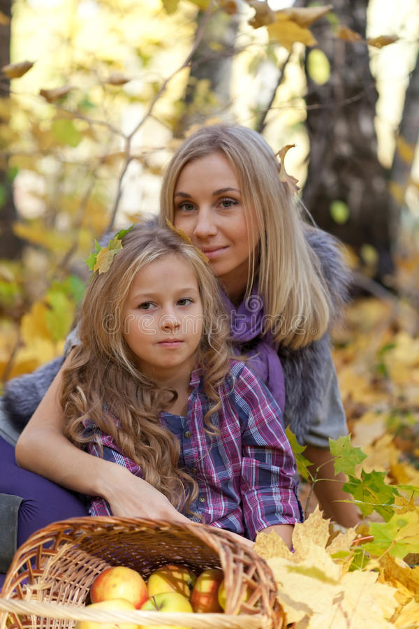 Happy mum and the daughter play autumn park royalty free stock image