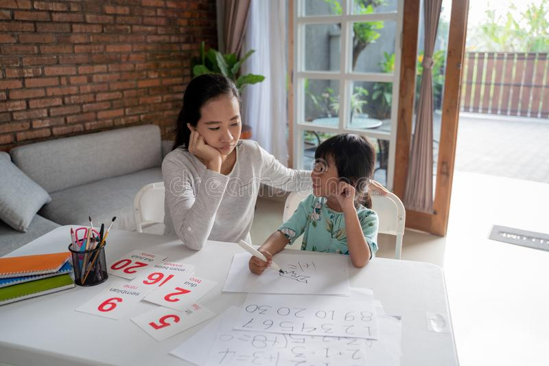 Mum and kid learning maths together at home. Happy mum and kid learning maths together at home stock photos
