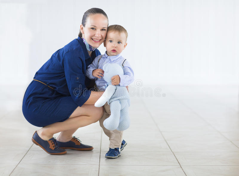 Happy mummy and her kid on a white background stock photography