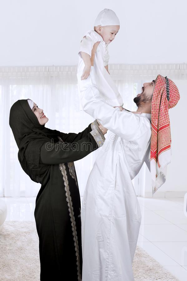 Happy muslim family isolated over white stock photo
