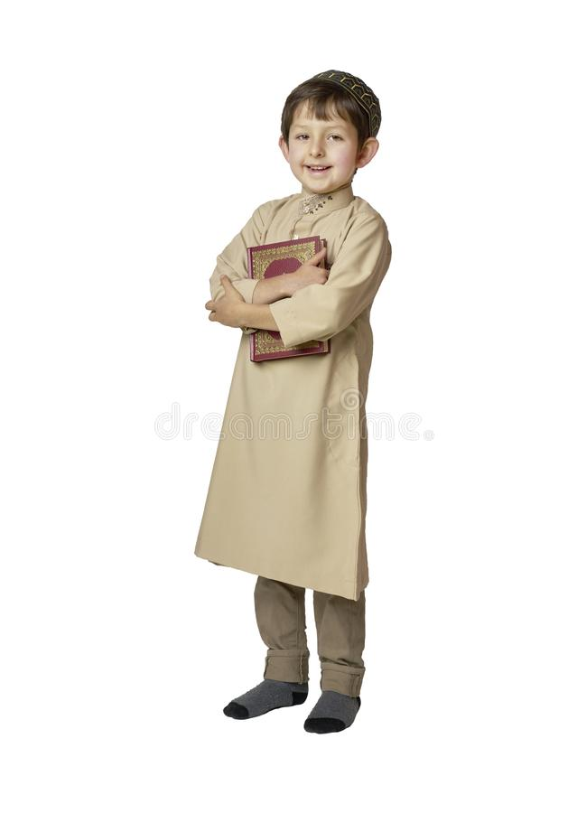 Happy muslim kid holding holy Quran on white background. Happy muslim kid holding holy Koran stock photos