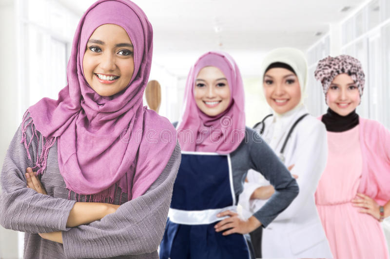 Happy muslim woman in different kind of profession stock image