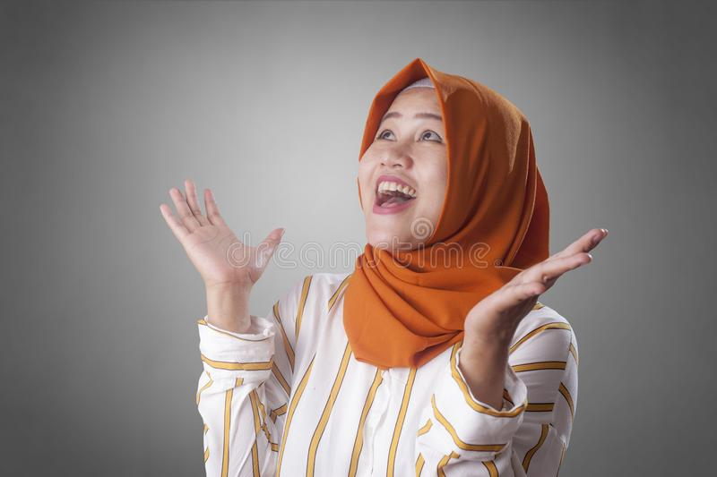Happy Muslim Woman Shows Winning Gesture Greeting Something royalty free stock image