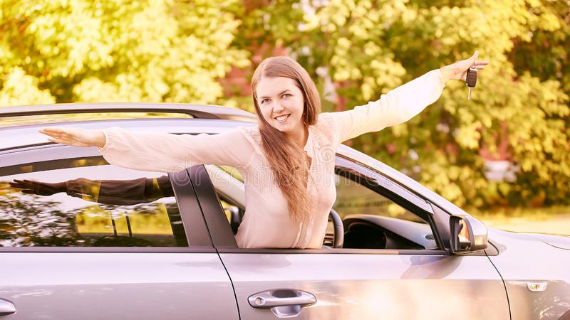 Happy new driver. Young person girl. Insurance vehicle.  royalty free stock images