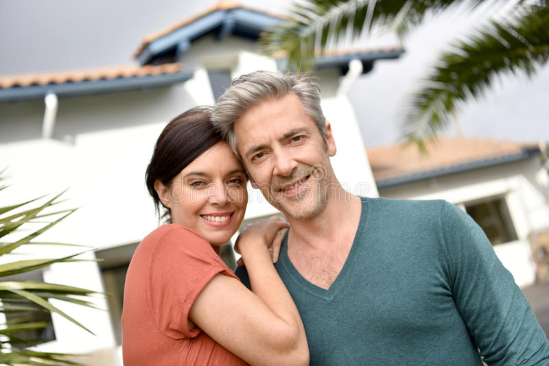 Happy new property owners stock photo
