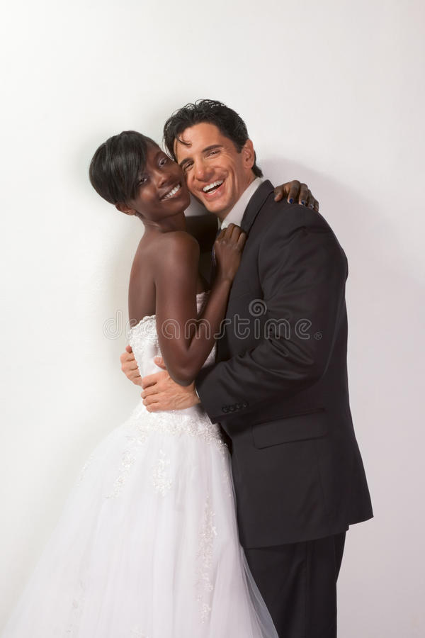 Happy new wed interracial couple in wedding mood royalty free stock image
