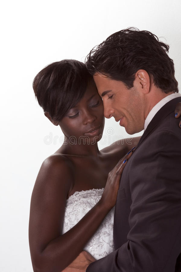Happy new wed interracial couple in wedding mood royalty free stock photos