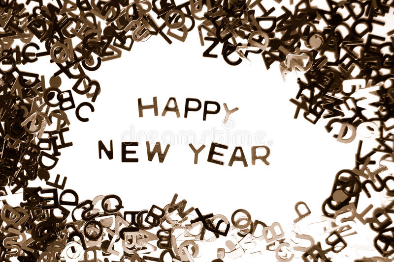 Happy New Year. Message made from miniature letters on white background (monochrome royalty free stock images