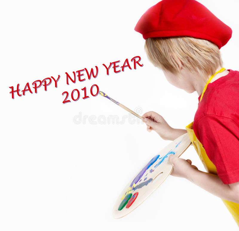 HAPPY NEW YEAR. Small artist in a red beret drawing HAPPY NEW YEAR royalty free stock photo