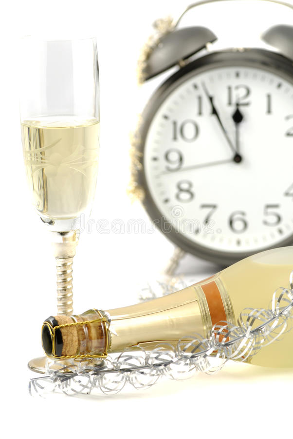 Happy new year. Background with champagne and Alarm clock royalty free stock photo