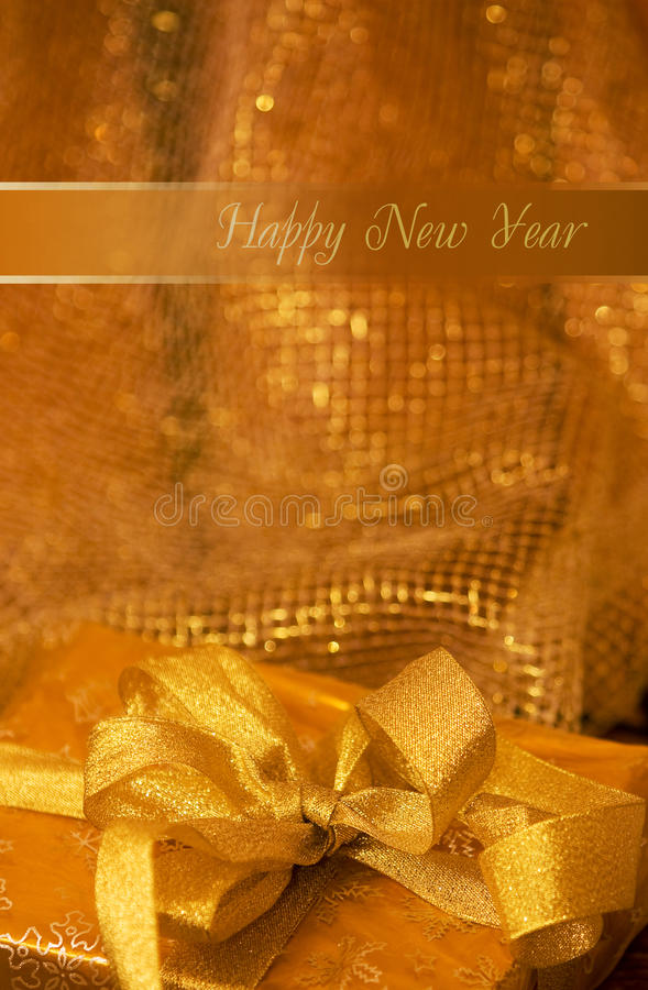 Happy New Year. Gift in a gold brown paper royalty free stock photo