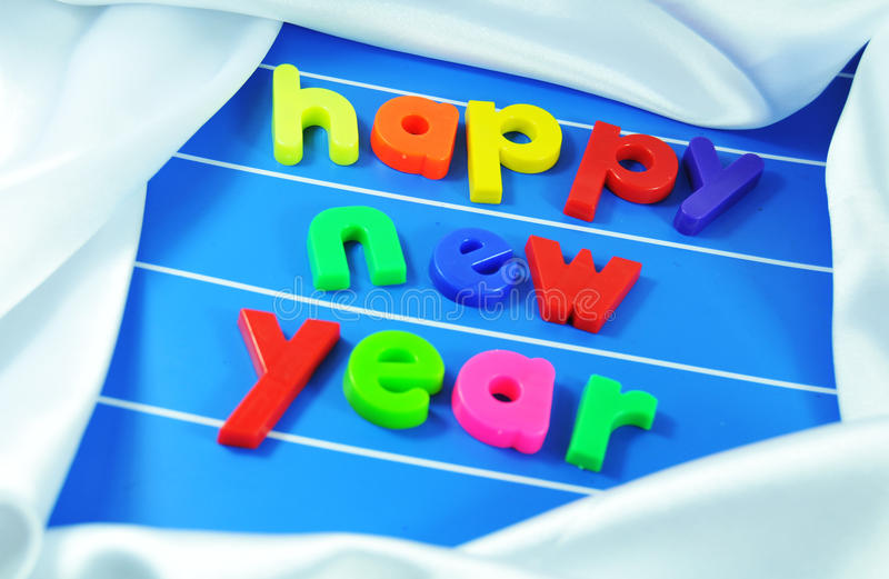 Happy New Year. Colorful message on silk background royalty free stock image