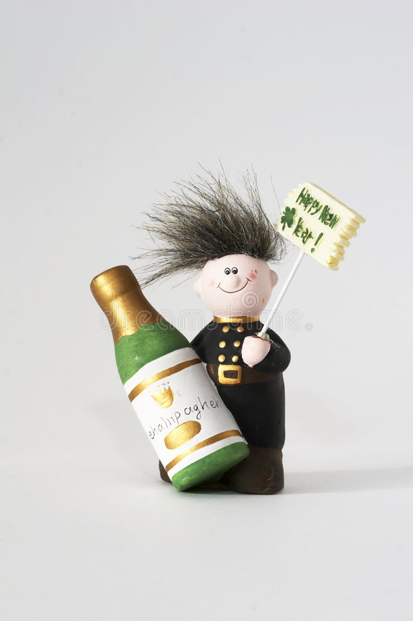 Happy New Year. Chimney sweeper with Happy New Year sign and Champagne bottle in his hand stock image