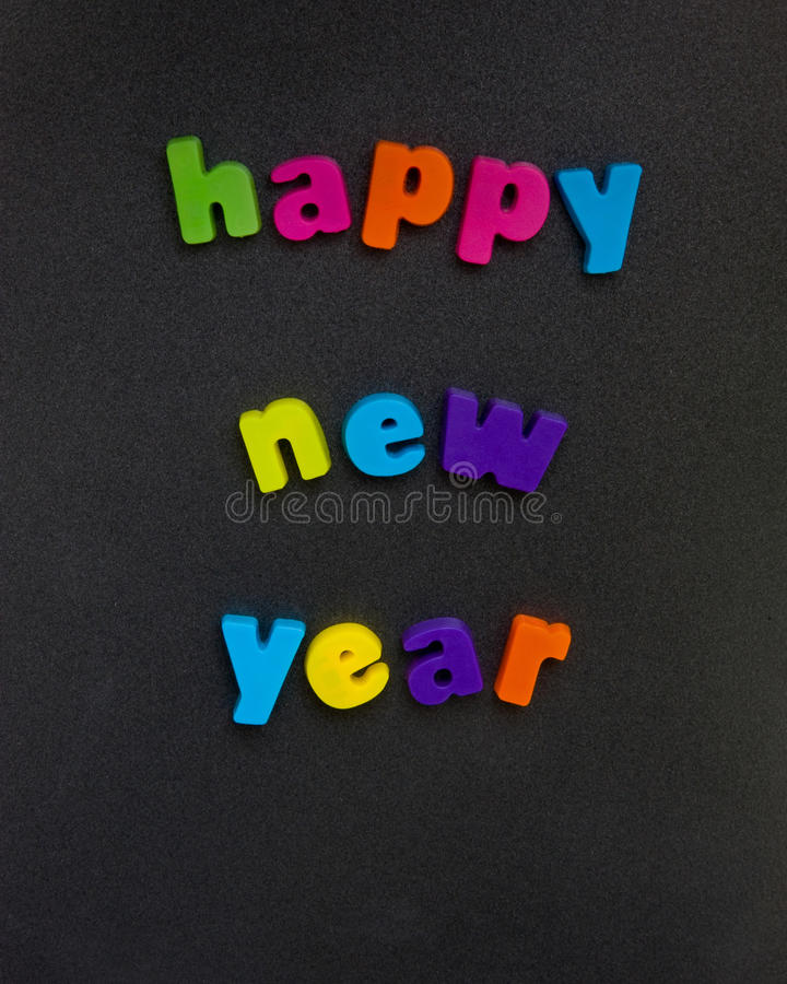 Happy New Year. An image of the message ' Happy New Year ' in bold colorful, lower case letters seen on a dark background stock images