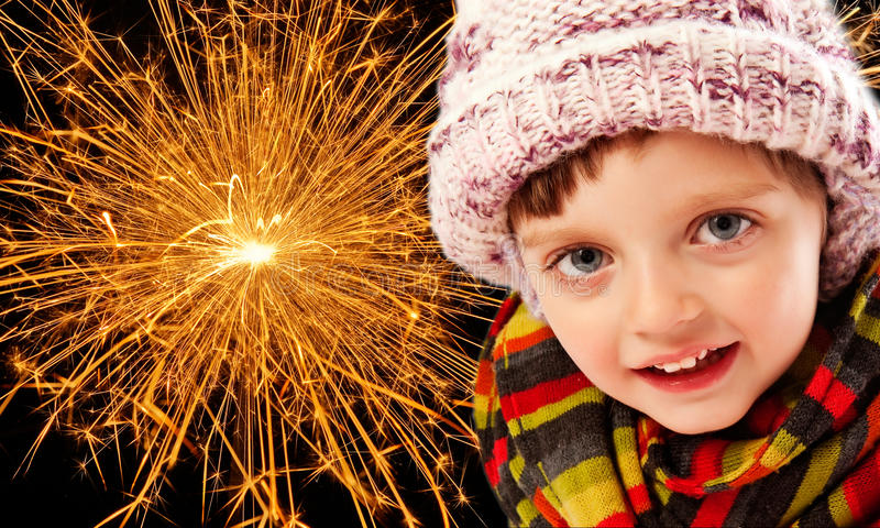Happy new year. Little girl and fireworks royalty free stock image