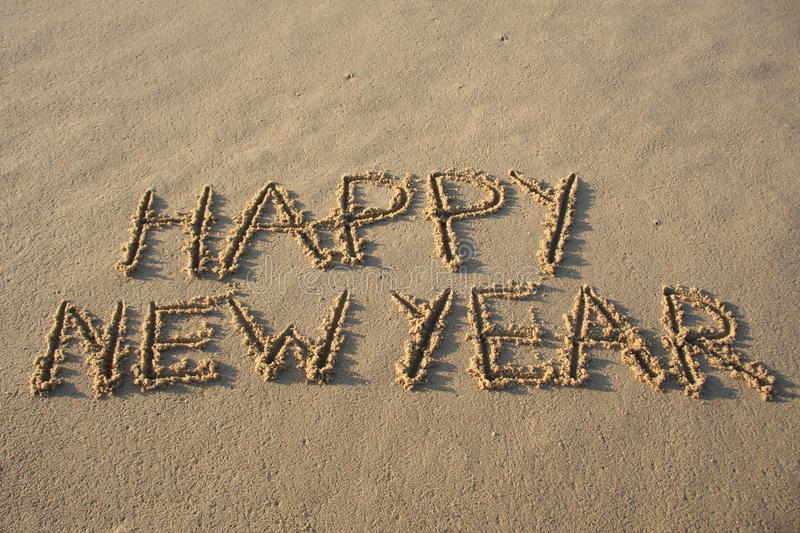 Happy new year. Written in the sand royalty free stock photos