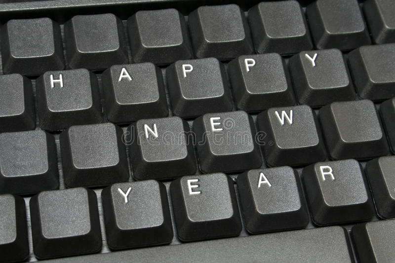 Happy new year. On computer keyboard, for people who must stay at work in that time royalty free stock photography